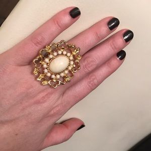 Large gold and cream cocktail ring